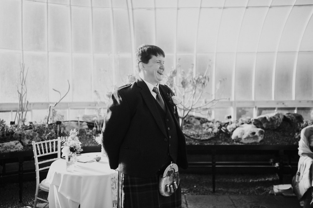 The happy groom is waiting for the bride to come in at the Botanic Gardens in Glasgow