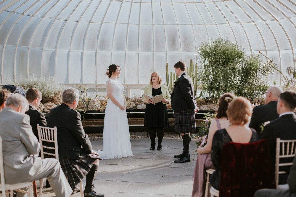Bride and groom at the ceremony in Glasgow Botanic Gardens
