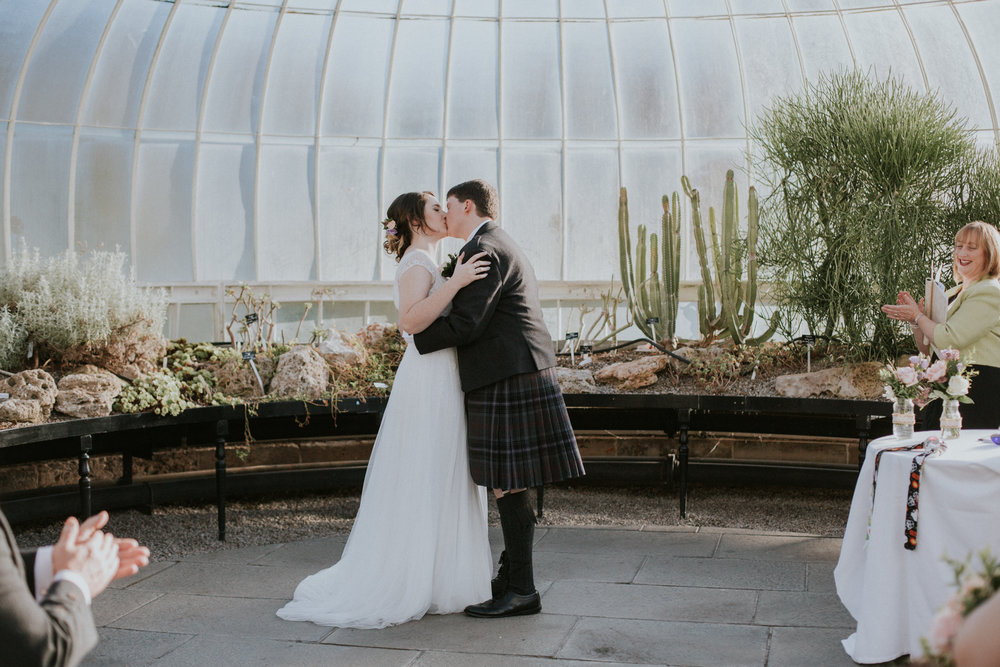 First kiss as a husband and wife at the Botanic Gardens in Glasgow