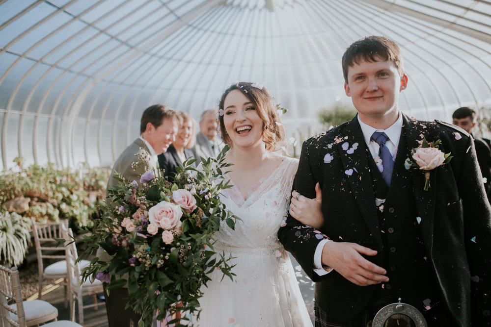 Happy Newlyweds after the stunning confetti shot