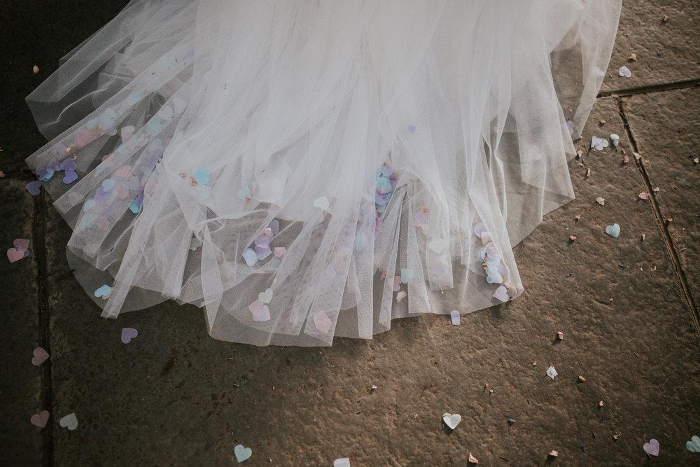 Confetti petals on the wedding dress