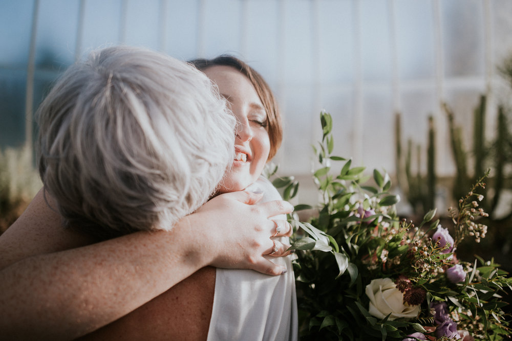Mother of the bride congratulates her daughter with the marriage