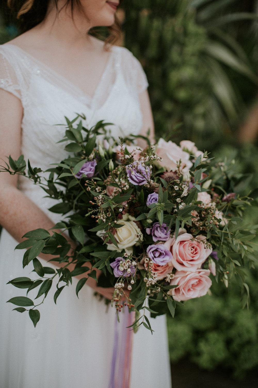 The bride wears the stunning Wed2b wedding dress
