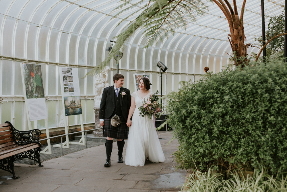 Bride and groom having a relaxed walk together after they become as a husband and wife
