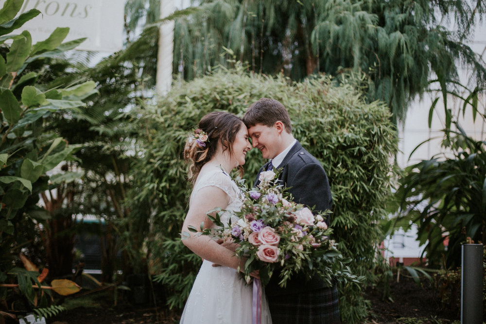 Happy and relaxed couple on their portrait photo shoot after the wedding ceremony at the Botanic Gardens
