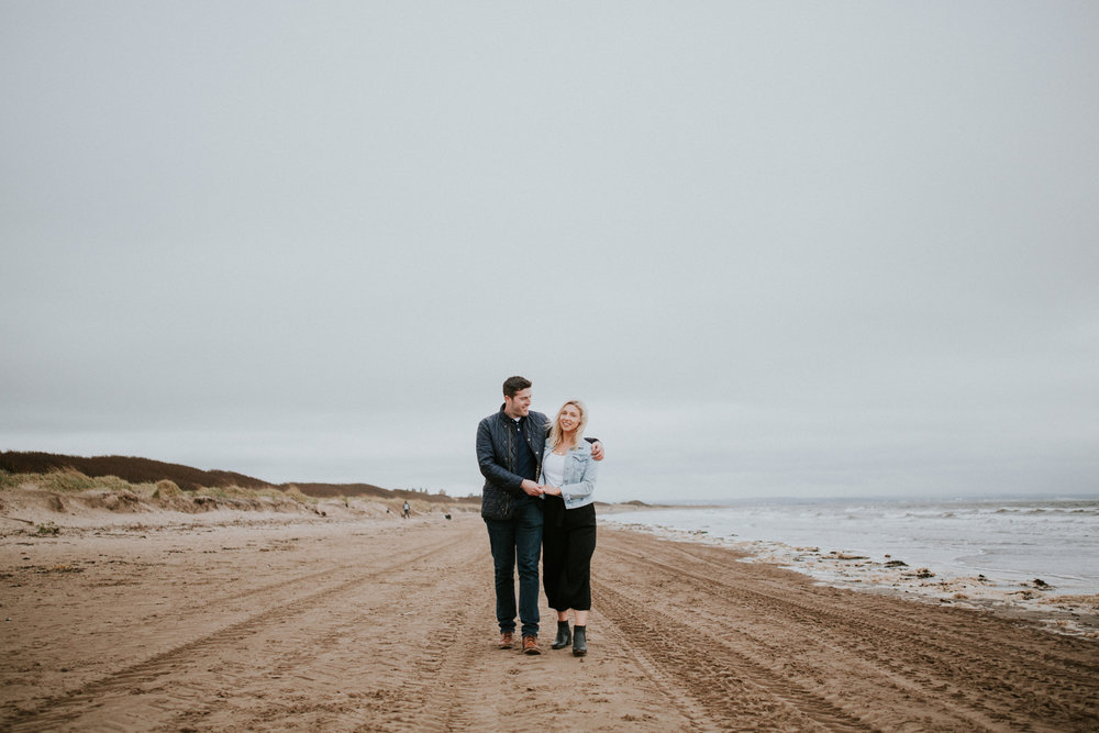 The couple is walking on the beach in Troon, Ayrshire wedding photographer
