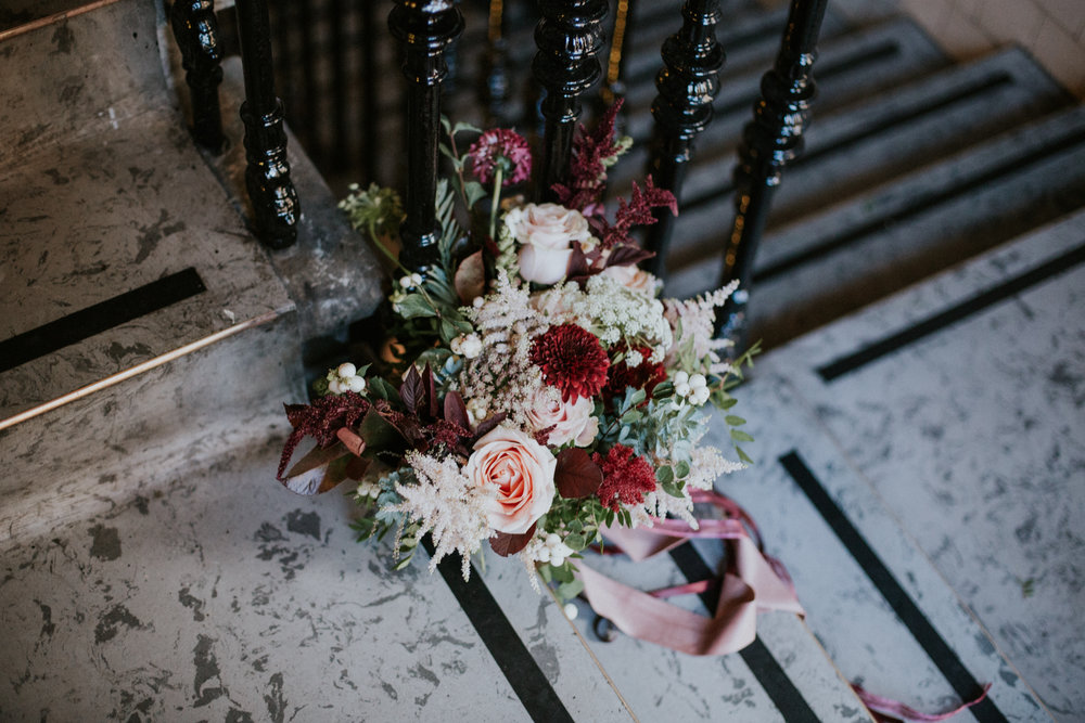 Floral Menagerie wedding bouquet on the ground of the industrial wedding venue in Glasgow