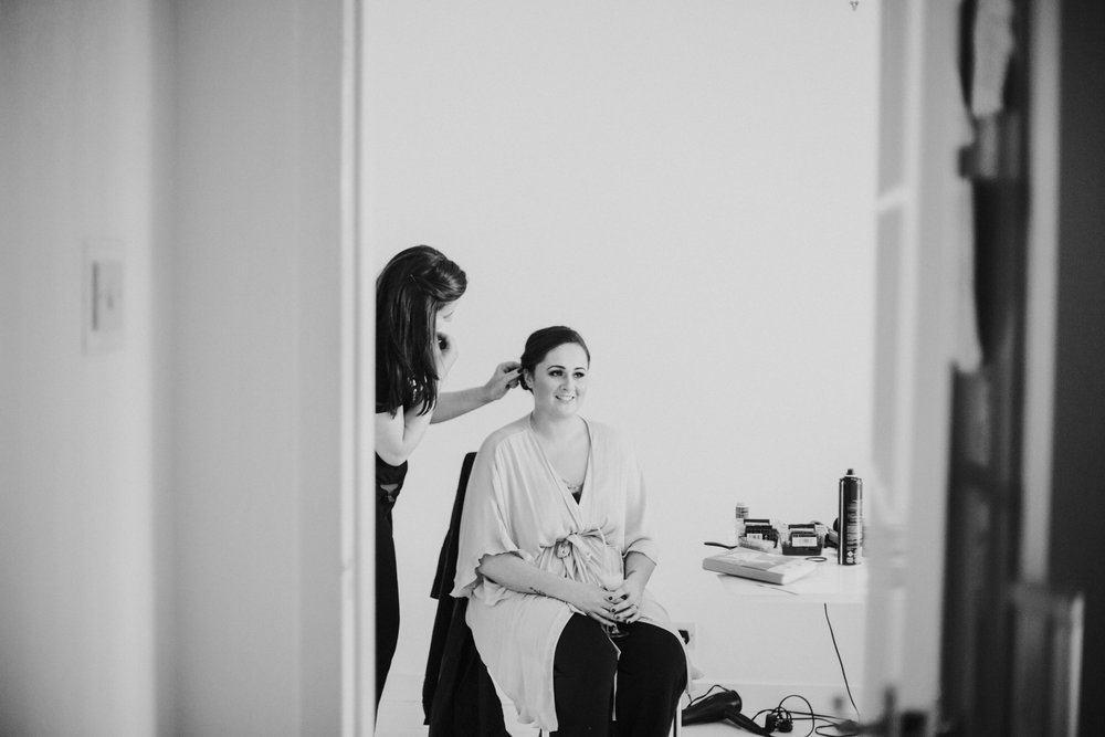 The bride is getting her makeup & hair done at her parents home