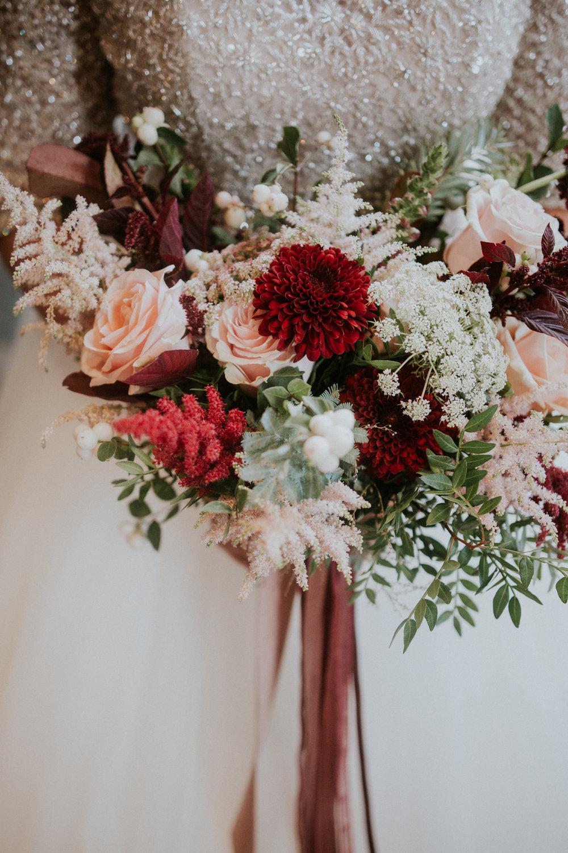 Close up bridal Floral Menagerie wedding bouquet
