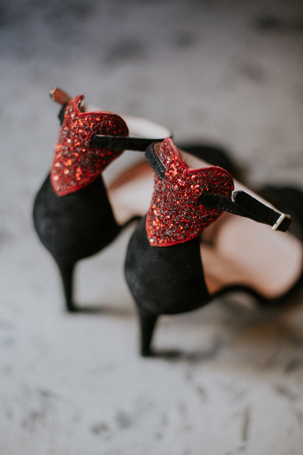 The black velvet with the sparkler red hearts wedding shoes presented to the bride from her beloved aunt