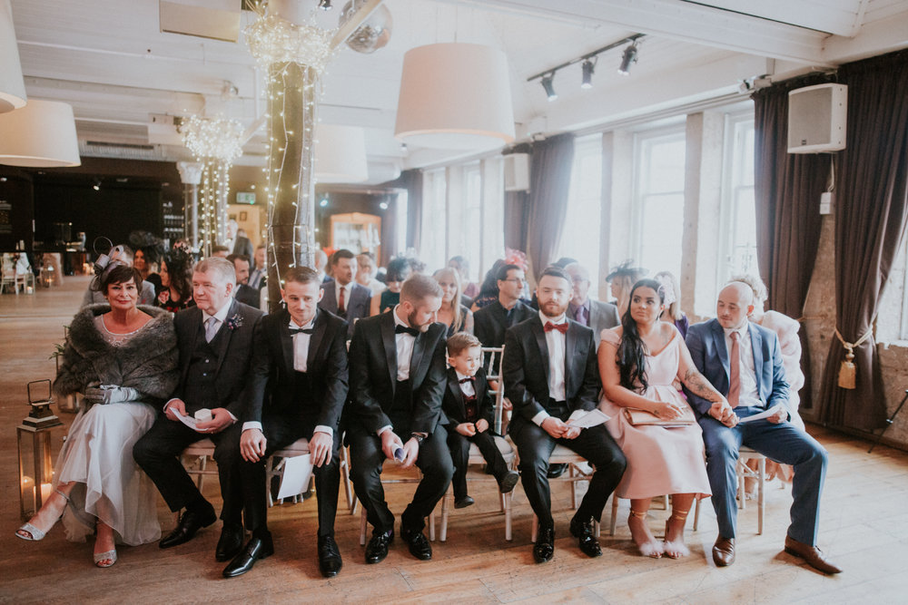 Guests and family at the wedding ceremony, a black tie wedding in Glasgow