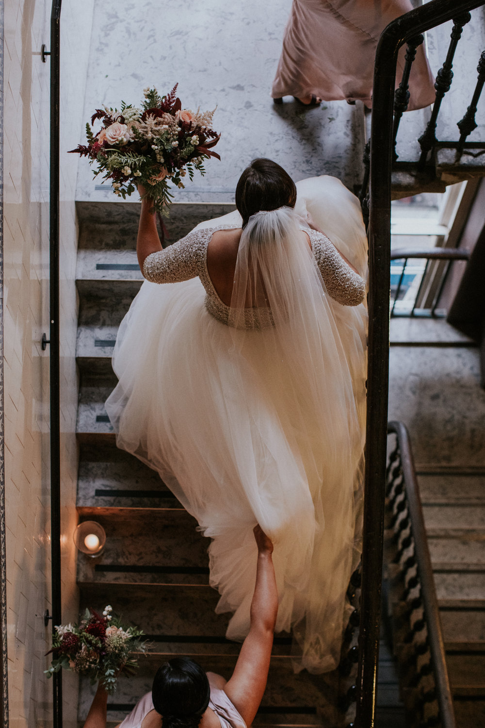 The bride with her bridesmaids are walking in the stairs to the ceremony room at the 29 Private members club in Glasgow