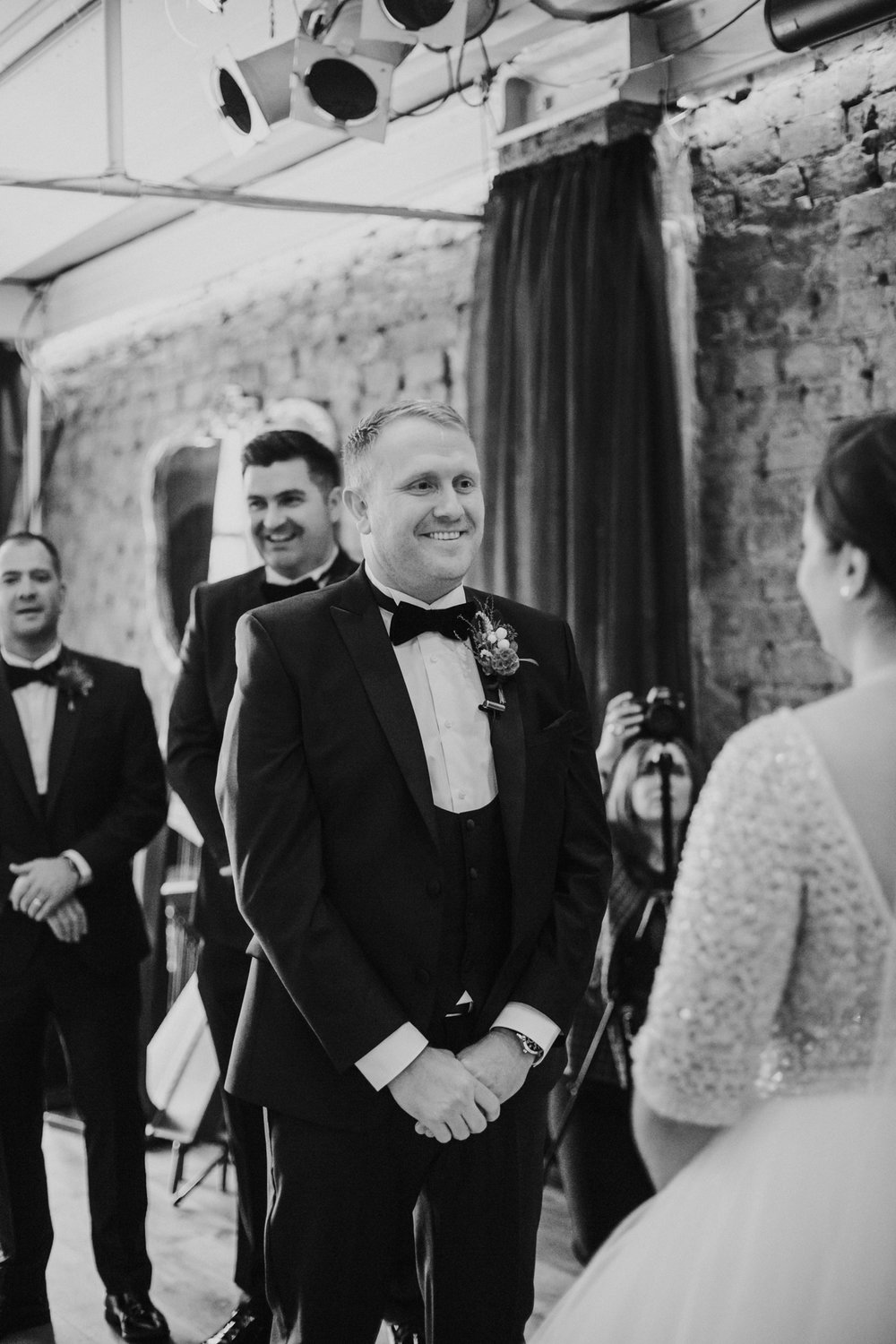 The groom so happy to see the bride for the first time