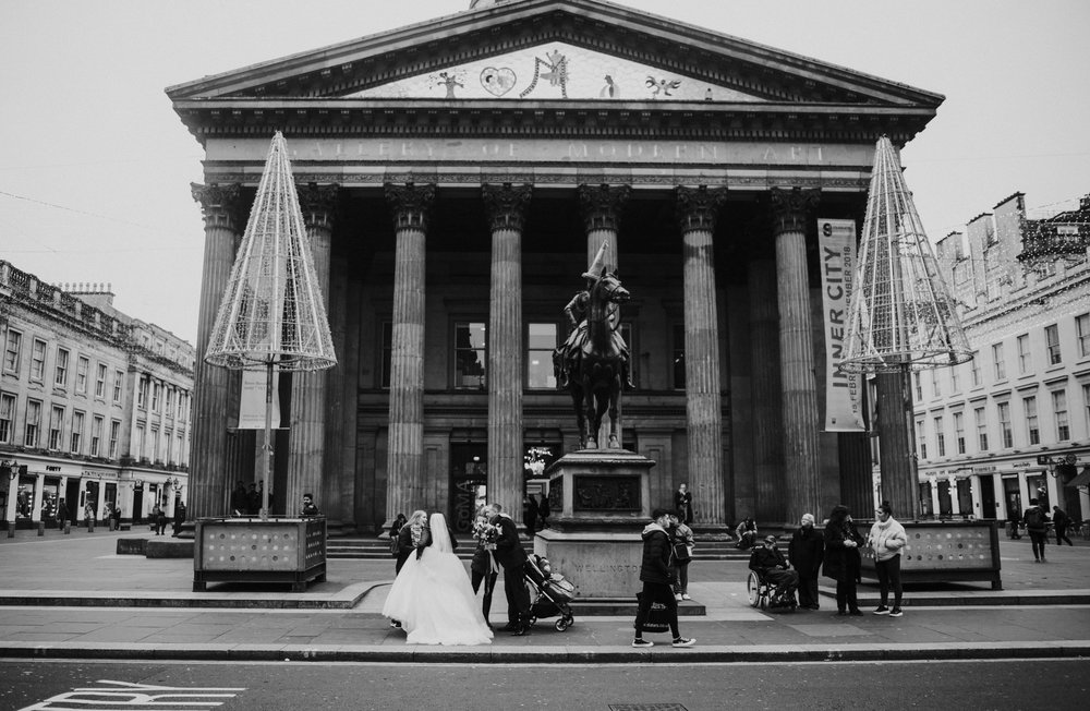 People congratulate the newlywed couple on the streets of Glasgow