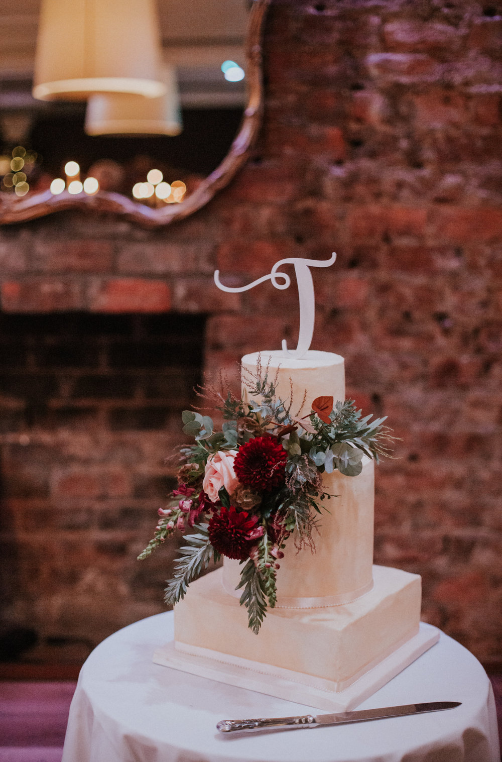 The wedding cake by Sara Giovino, flowers by Floral Menagerie