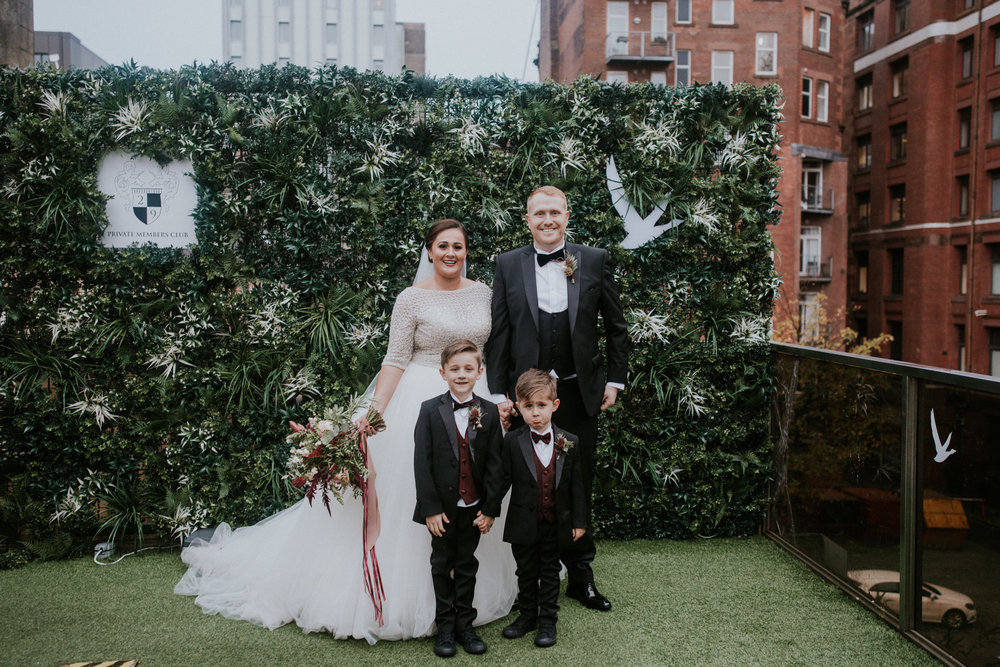 The newlywed with their sons on a family formals portrait
