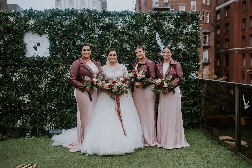 Bride with her bridesmaid for the formal portrait