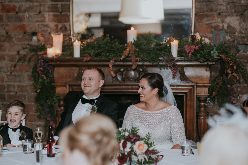 The newlywed couple is laughing on the speeches at 29 Private member club in Glasgow