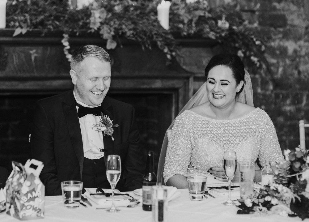 Bride and groom are laughing at the speeches at 29 Private members club in Glasgow