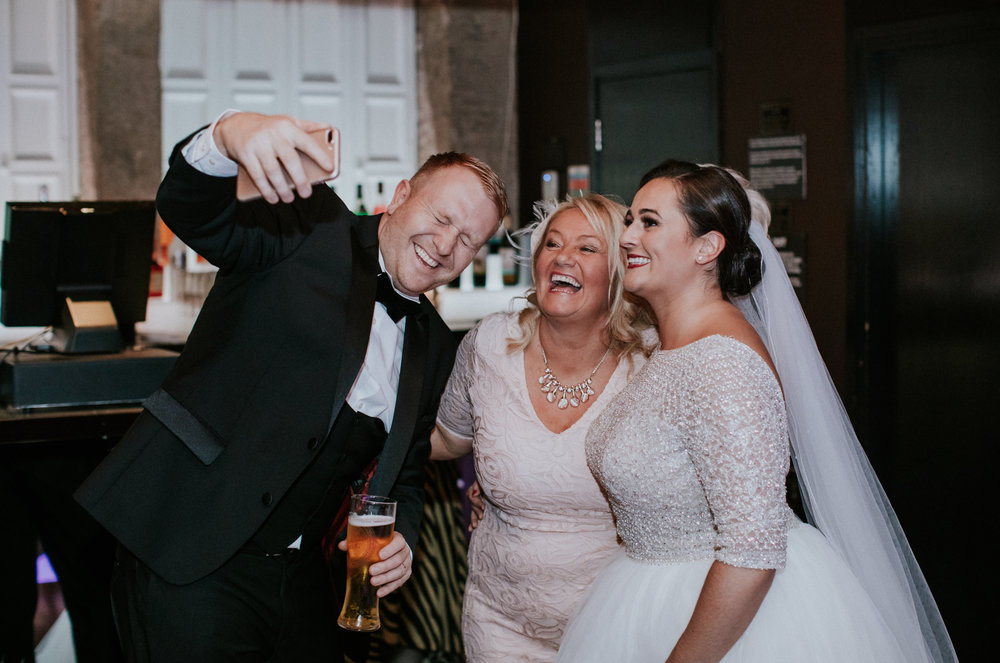 Bride and groom are laughing with the guest at the evening reception at 29 Private members club in Glasgow