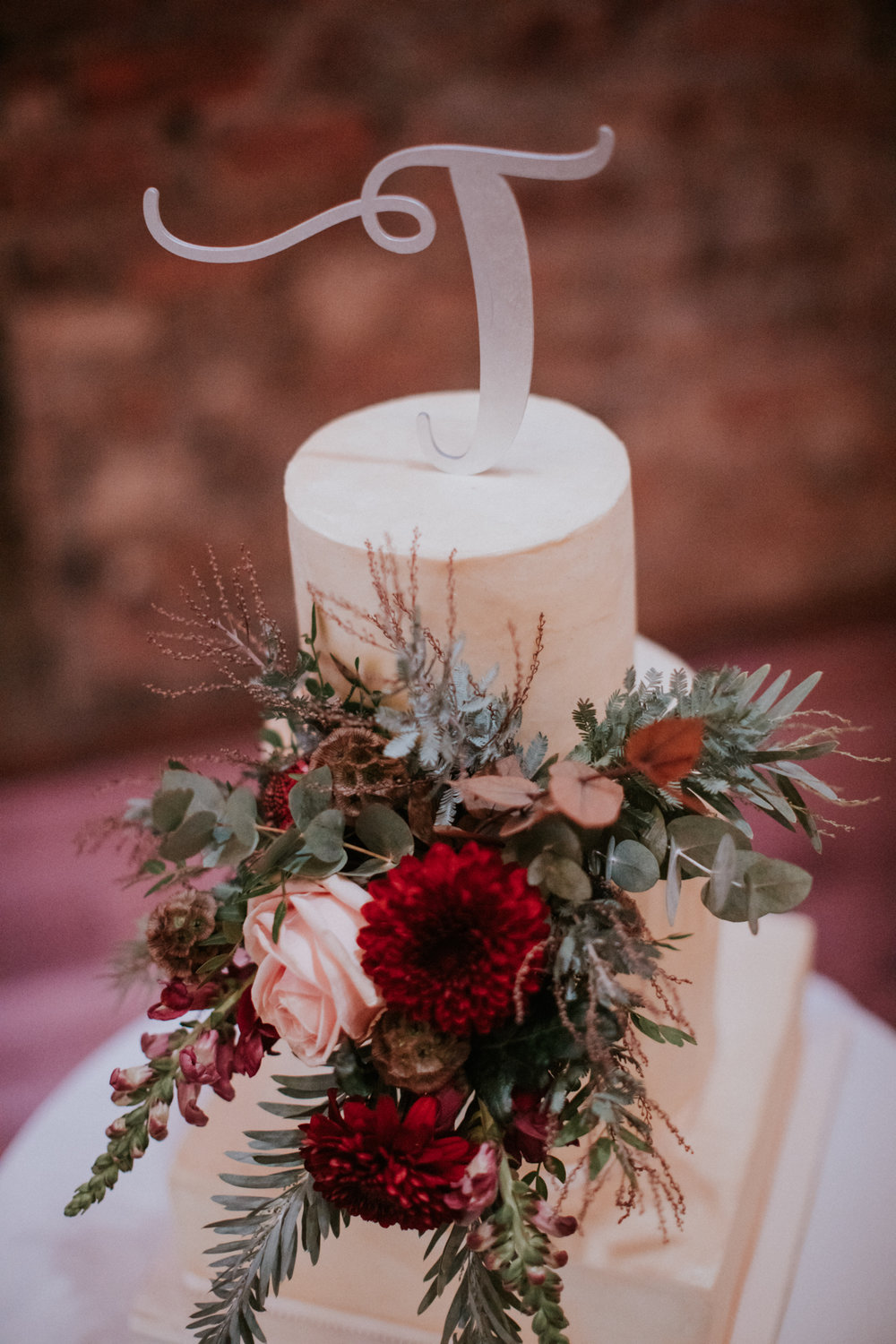 The naked wedding cake with the stunning flower decor from Floral Menagerie