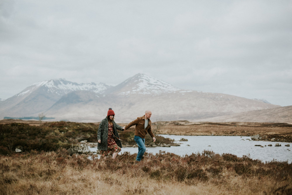 The engaged couple is exploring the Scottish Highlands for their pre-wedding photoshoot in Glencoe
