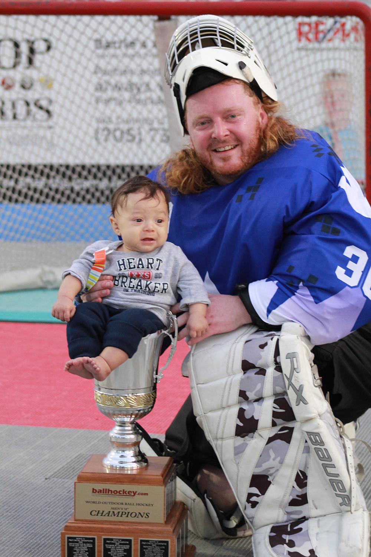 baby in trophy.JPG