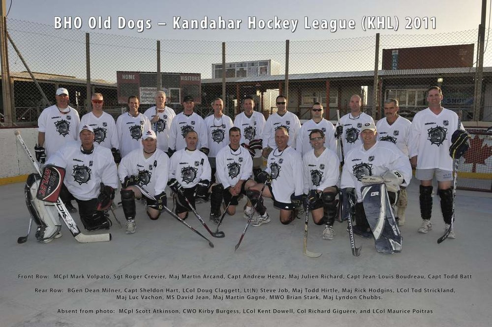 A photo of a team ballhockey.com sponsored in front of the old scoreboard from the Barrie Ball Hockey Club that was donated in 2011.