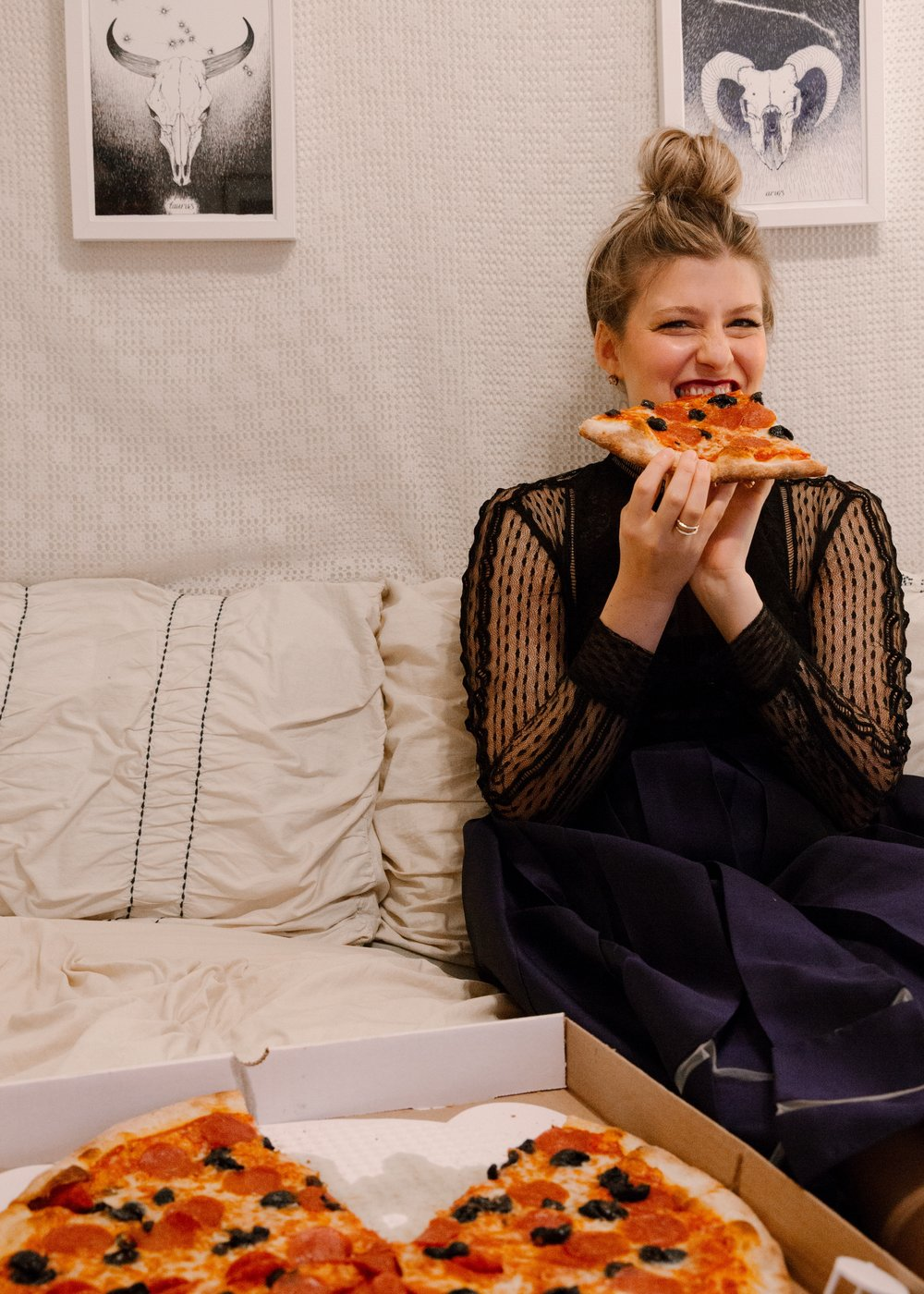 me eating pizza, photo by Lindsay Brown