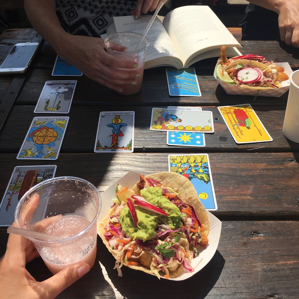my gals and me have a tarot card reading over some fish tacos, as you do.