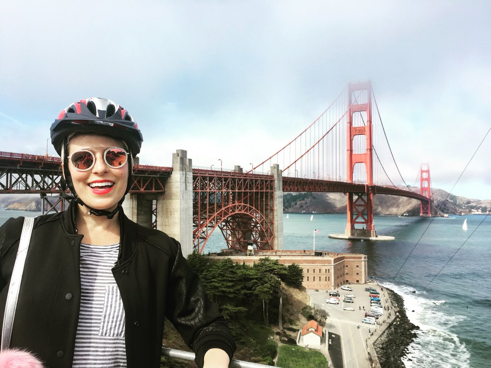 girl biking the golden gate bridge