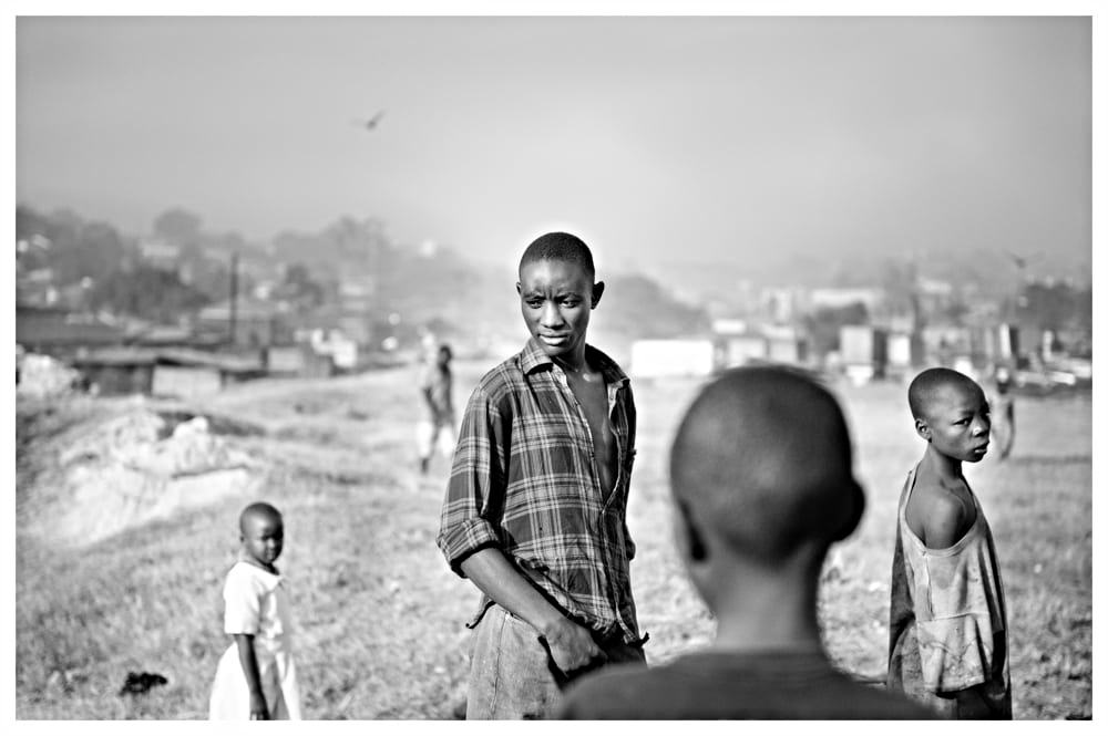 The Street Children Wander The Mountain Top Outside Kampala's Slum