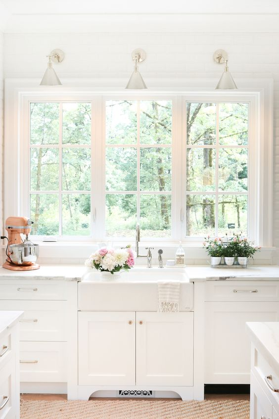 At first glance, I loved the way this kitchen looked with these three big windows looking out to into nature so we did just the same thing.