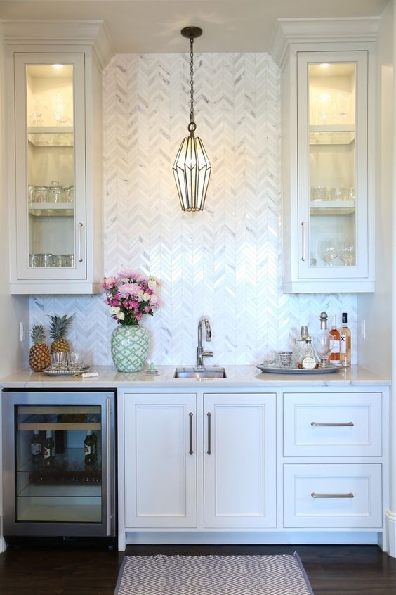 Bar will have a beverage fridge, sink and extra storage with drawers and cabinets above. Image via Pinterest via  Old Seagrove Homes .