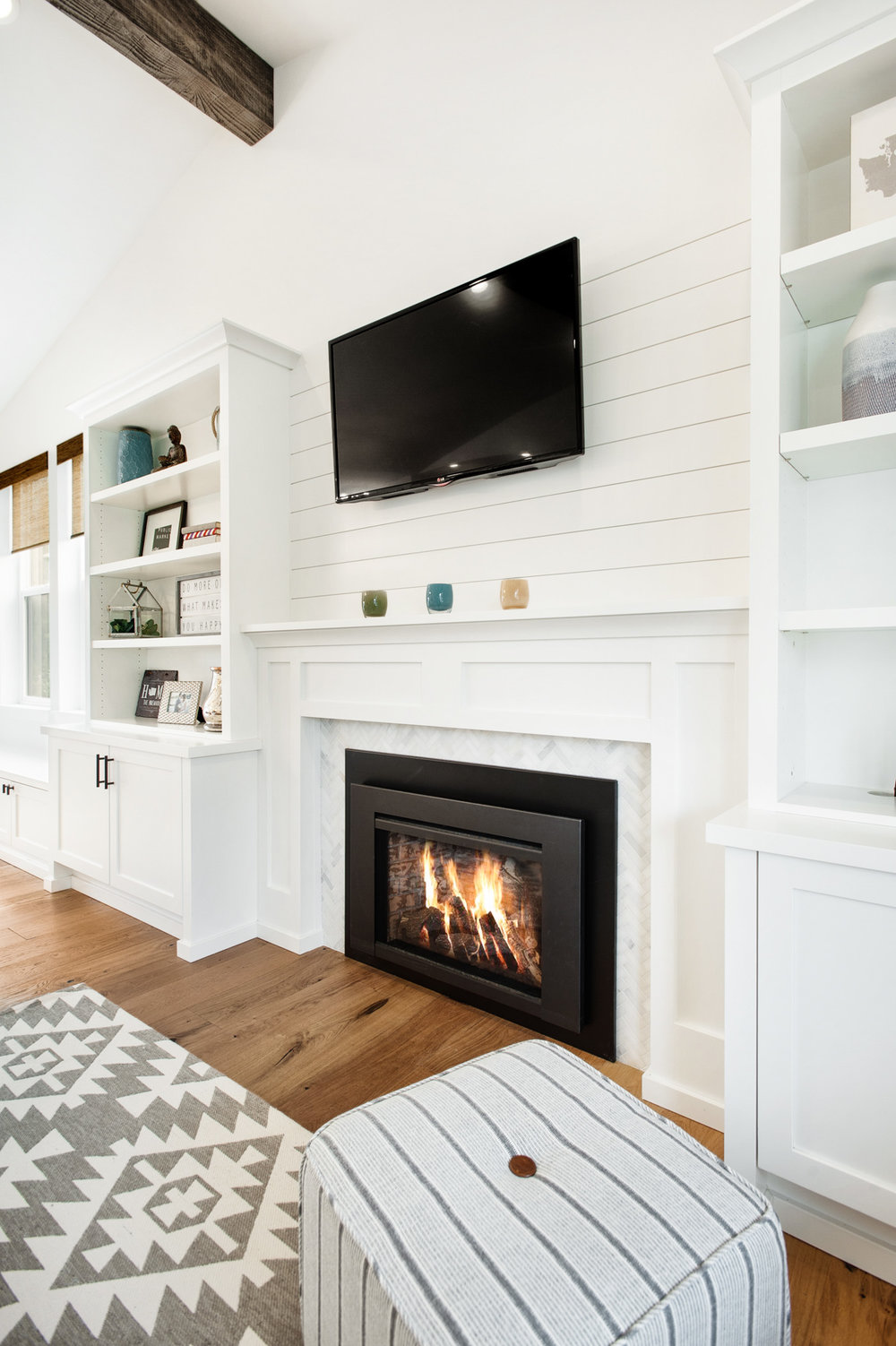 Switching from a wood burning to a gas fireplace was a game changer. It makes the space so much cozier and energy efficient!