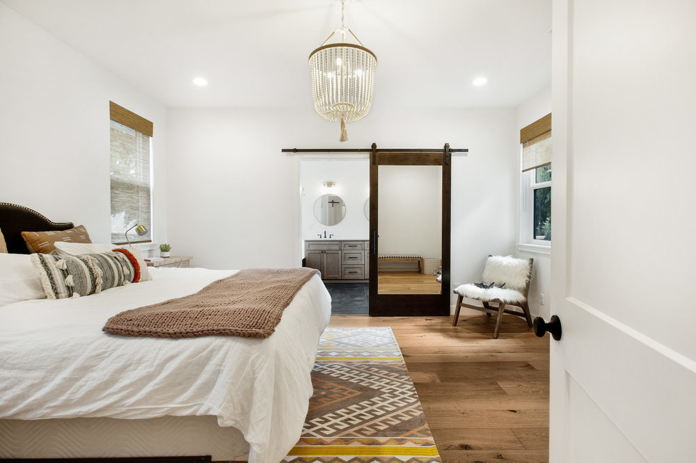 Master bedroom - still so much decorating to do in this room! My favorite part is the chandelier.