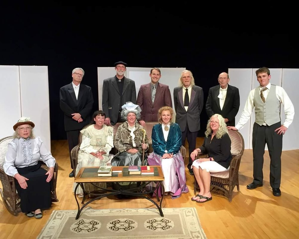Cast picture from The Importance of Being Earnest, June, 2016, Tannery Pond Community Center, North Creek, NY. L to R: Barbara Westbrook as Miss Prism, Anne Vaccaro as Miss Cecily Cardew, Robin Jay as Lady Bracknell, Hannah Jay as Honorable Gwendolyn Fairfax, Karen Munoz as technical supporter extraordinaire; Mike Corey as butler's assistanc, Dennis Wilson as Reverend/Doctor Frederick Chasuble, Dan Studnicky as Algernon Moncrief, Dave Myers as Lane, Andy Studdiford as Merriman, Ben Hinckley as Jack Worthing.