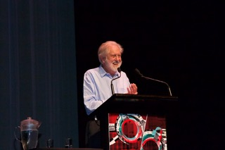 Lord David Puttnam delivering his presentation  For The Love of Cinema   to a packed theatre ; picture courtesy of CILECT