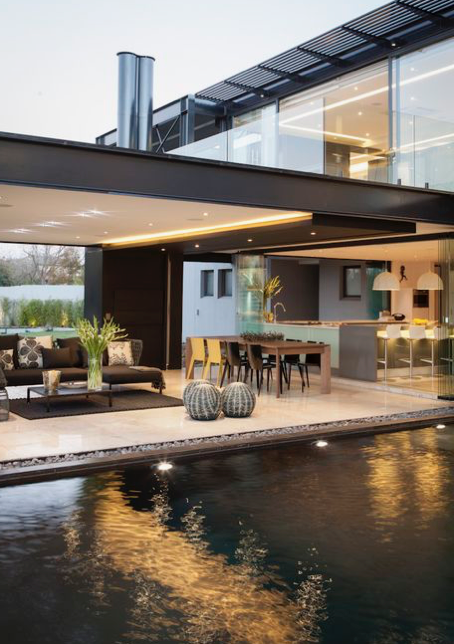 The living space protrudes out into the garden, under the main roof. Pic courtesy of Pinterest .