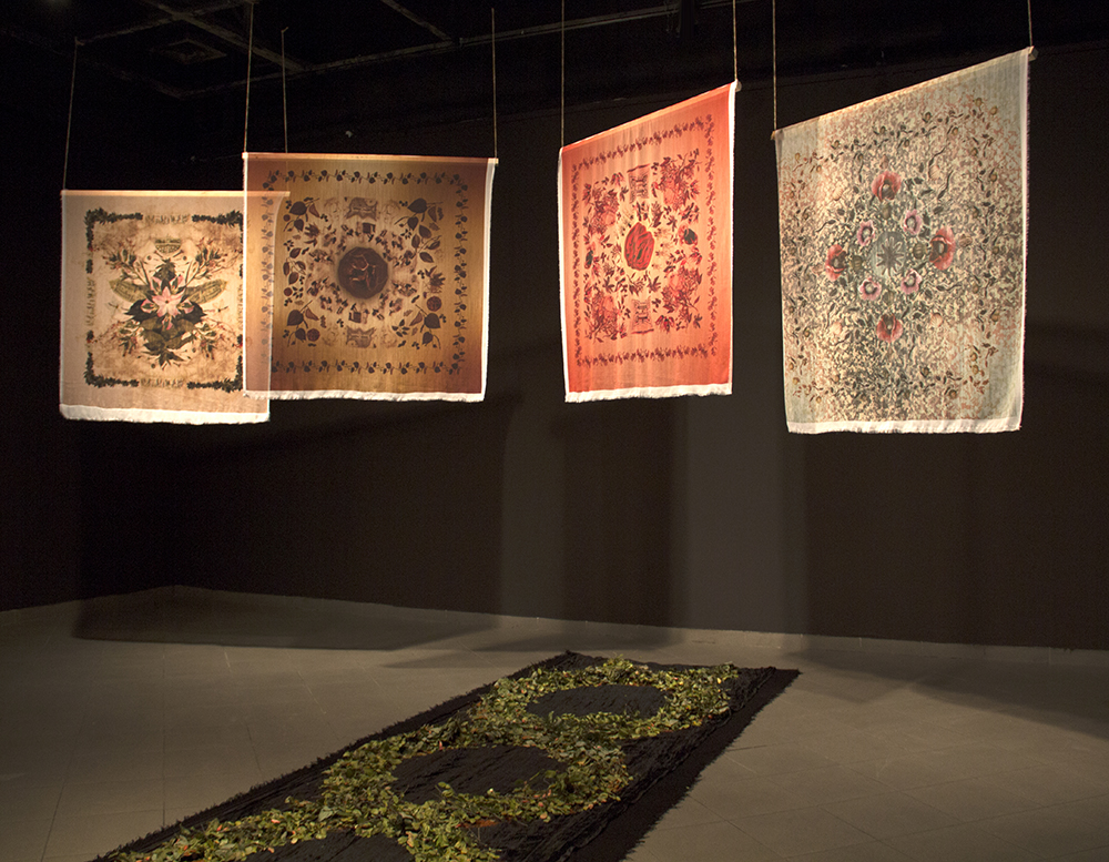 Spice Route Series August 2016, Installation of digital prints on silk, each 54 in. x 54 in.   |    Installation view at Museo Nacional de Bellas Artes de Chile, Museo Sin Muros These silk prints depict the social history of plants, while borrowing from the aesthetics and history of Mantones de Manila, which were silk shawls introduced as Asian luxury goods to the Americas and Europe and then popularized by flamenco dancers.