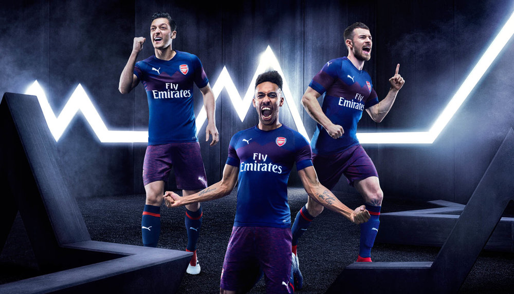 arsenal-away-18-19_0000_18aw_xts_afc_key-visual-away-trio-h_rgb.jpg