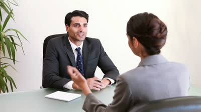 stock-footage-two-business-people-talking-during-an-interview-in-an-office-1.jpg