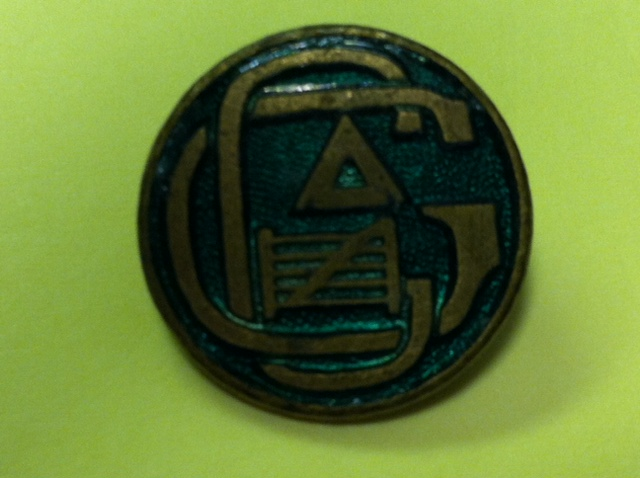 Logo del club Gateway en un pin