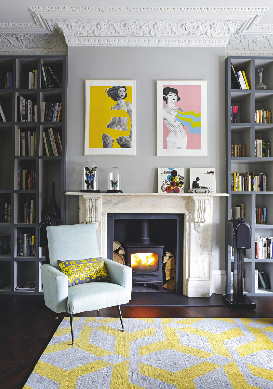 Gerald Laing's pop art prints liven up this lovely living room. Photo: Livingetc
