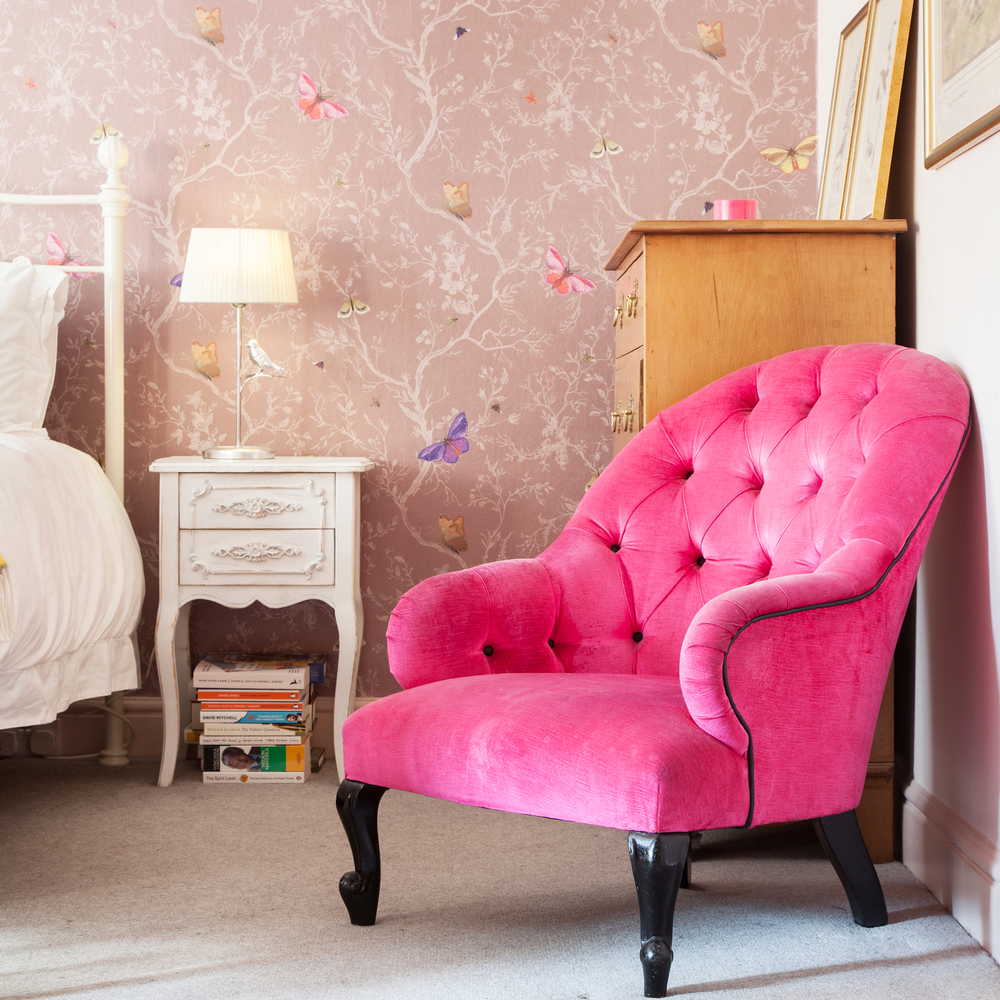 The hot pink armchair from Tann Rokka, bought in the days when weekends really were weekends/Photo: Susie Lowe