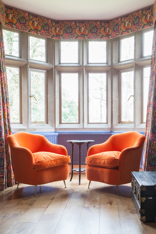 Orange velvet armchairs