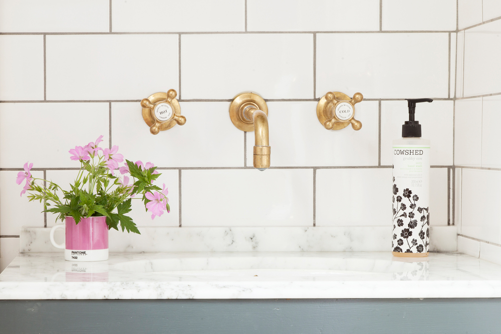 Brass taps and marble sink top = true happiness/Photo: Susie Lowe