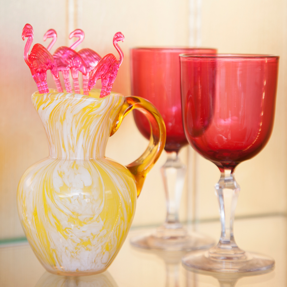 Pink vintage glasses and flamingos in The Pink House bar/Photo: Susie Lowe