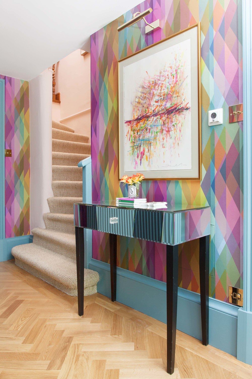 The Pink House basement hallway with Cole & Son Prism wallpaper