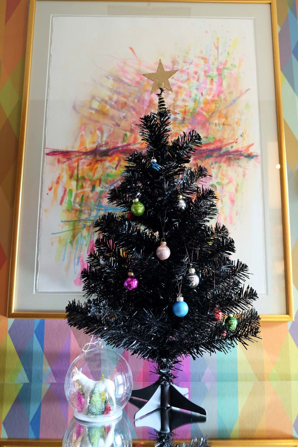 Unicorn bauble and multi-coloured baubles on tree: Rockett St George/Wallpaper: Cole & Son Prism/Painting: Dale vN Marshall